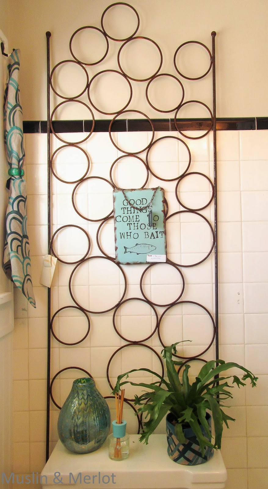 Garden trellis used as wall art. This was my favorite bath decor item.