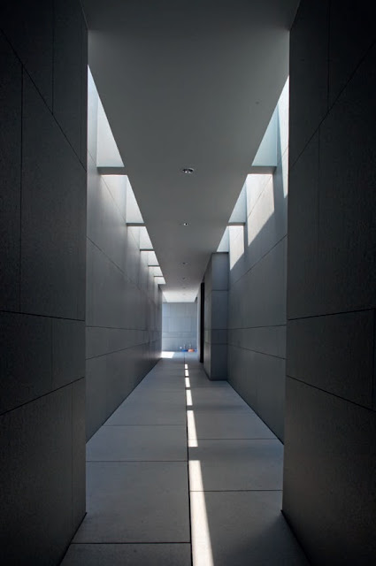The dramatic top-lit service corridor