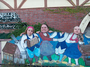 The three girls pose in front of the Hans Christian Anderson shops