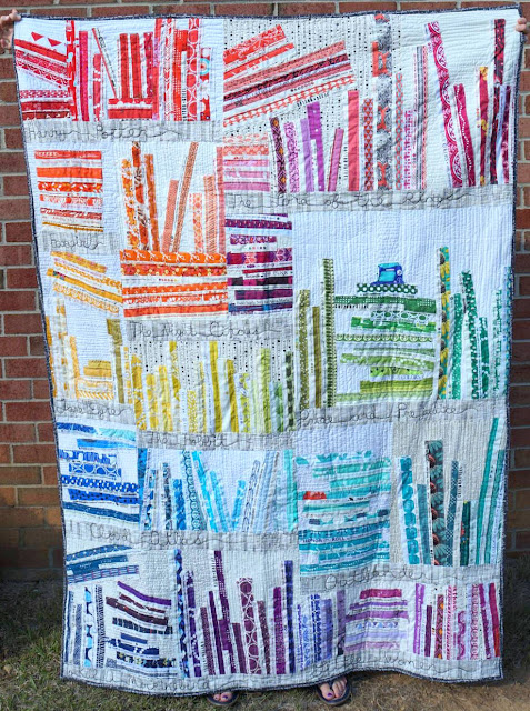 http://www.quiltyhabit.com/2015/09/selvage-rainbow-bookcase-quilt.html