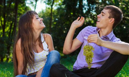 9 Top Attraction Secrets Men Should Know,man woman eating grapes love romance nature trees