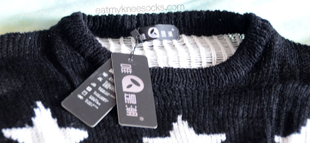 Dresslink's $10 star sweater is made of a nice quality, with all tags attached.