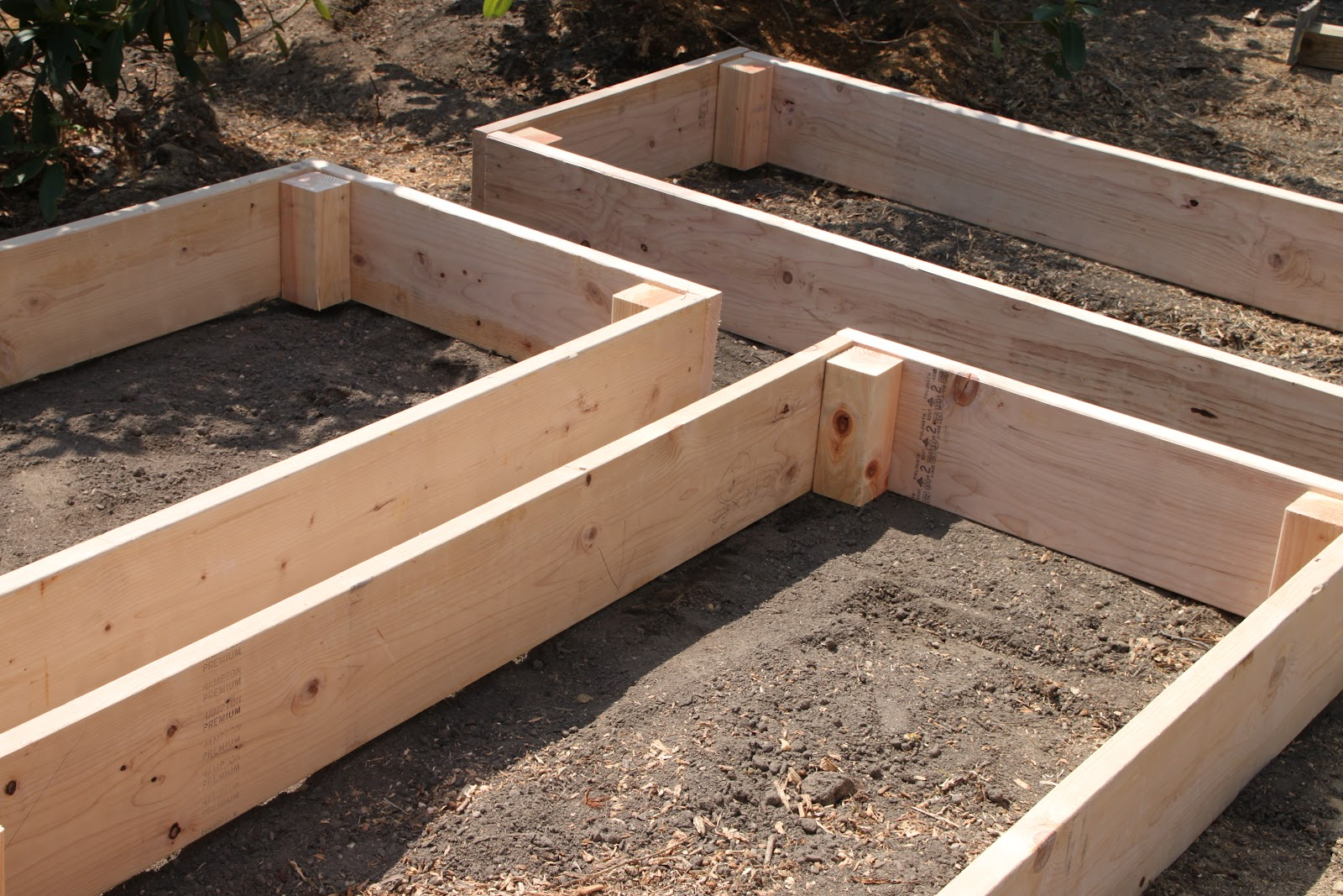 Tilly 39 s nest easy diy raised garden beds for Cheapest way to make raised beds