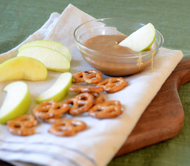 The best caramel dip that is made on the stove with butter, sugar, and sweetened condensed milk that is the perfect texture for dipping pretzels and apples into.
