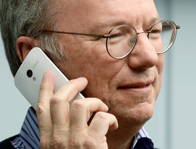 Google CEO Eric Schmidt holding the Motorala X Phone