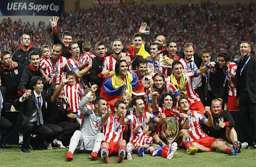 Atlético Madrid players celebrate after winning the European Super Cup