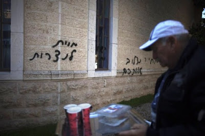 death threats on the walls of the Baptist House church in  Jerusalem