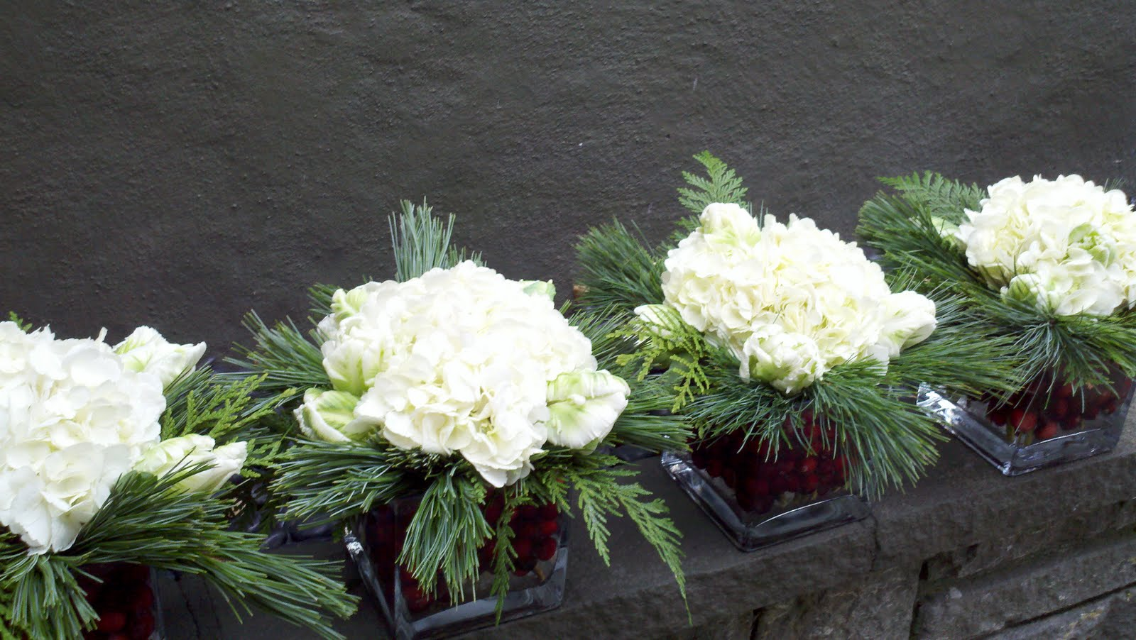 Winter holiday florals juniper flowers White christmas centerpieces