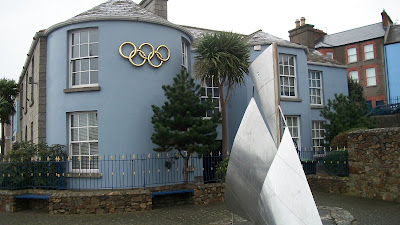 There is a blue building in downtown Howth with the Olympic Rings on it that is the Irish headquarters.