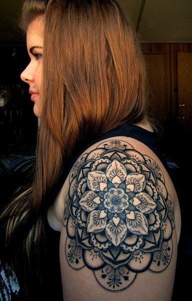Big black ink flower tattoo on arm