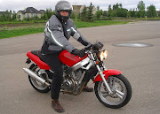 My Honda Hawk looked like a pocket bike on him. Roland gives the term 'knee .