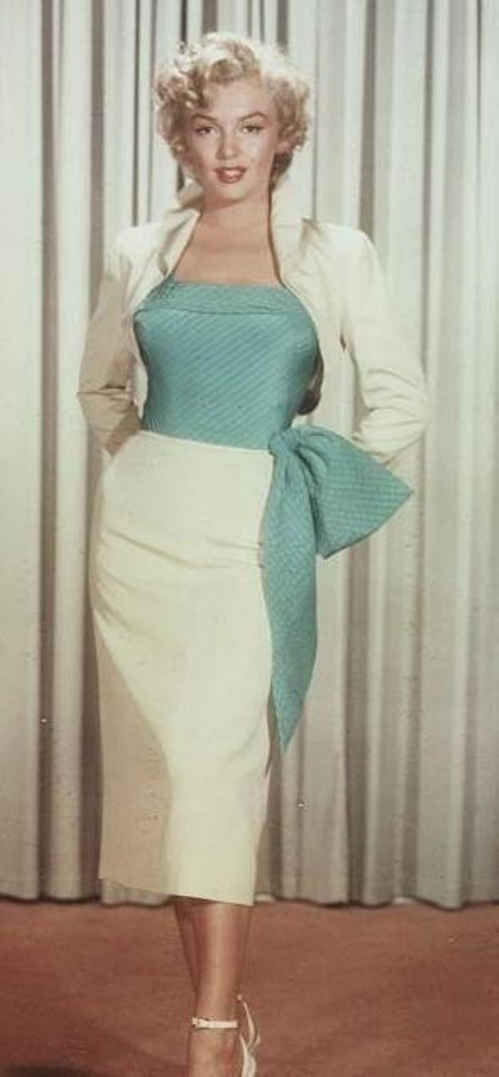 Marilyn Monroe wears white suit at a costume test for Niagara