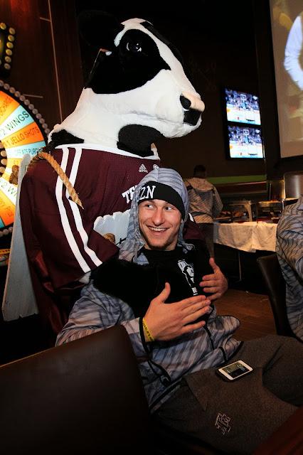 Johnny Manziel meets a Chick-fil-A Cow.