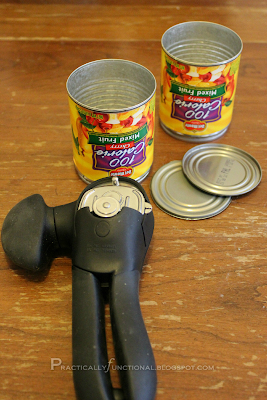 Opened tin cans with can opener