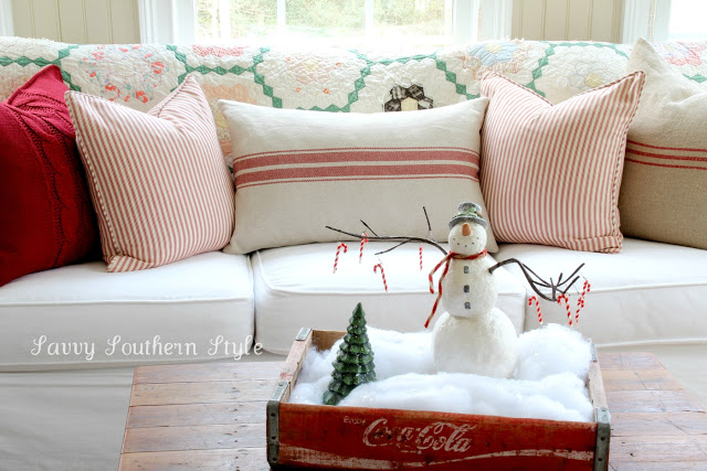 Snowman in a coke crate vignette, by Savvy Southern Style, featured on I Love That Junk. Check out this tour for the entire sunroom!