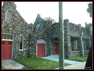 red doors on an old stone church