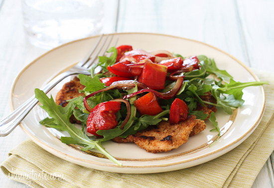 Breaded chicken cutlets, baked in the oven topped with arugula ...