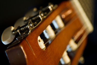 Tune Up - a photograph of the tuning pegs on a guitar