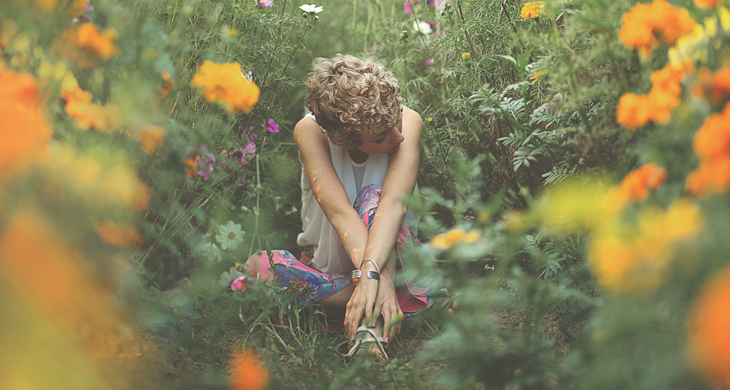 photography of das sheep sitting in the middle of flowers, in a romantic pink outfit of the day