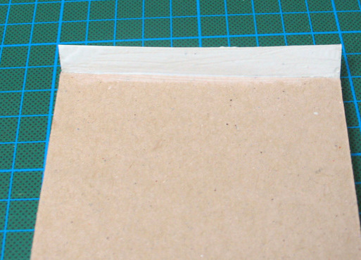 gluing the cover to the back cover of your handmade notepad - tutorial