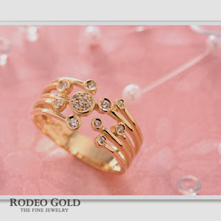 http://www.rodeogold.com/gold-rings-for-women/14k-18k-gold-rings-twr00675#.UpoJUY2ExAI