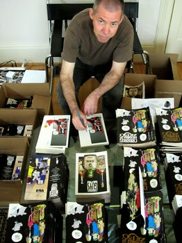 Dave Sim surrounded by his work