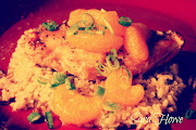 . with scallions and mandarin oranges scattered over the top. (chickenmandarinoranges)