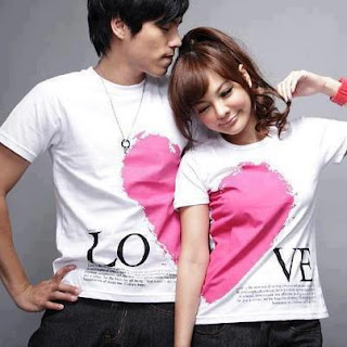 couple with white shirts and pink heart
