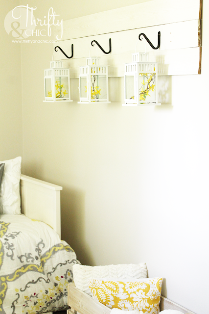 Cute way to hang lanterns, using hooks and reclaimed wood.