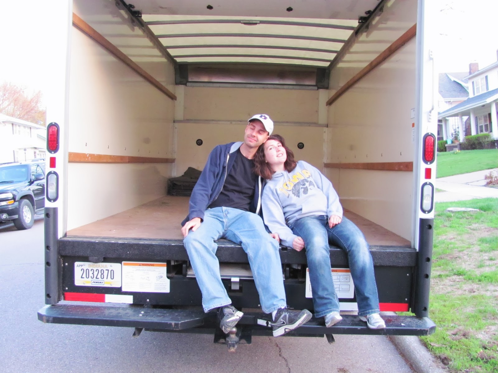 Cory and Sara relaxing in front of the empty truck after a VERY long day.