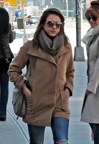 Jessica Alba wearing a camel coat