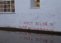 Ironic message in graffiti painted on a wall in London. (Image Credit: Matt Brown via Flickr) Click to Enlarge.