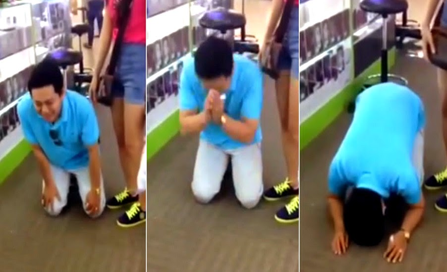 Vietnamese Man Kneels iPhone 6 Discount Singapore