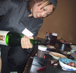 Serving saki - rice wine in Japan