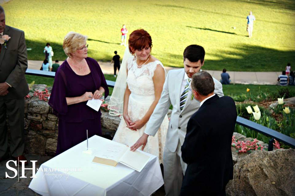 Wedding Officiant Signs The Bible