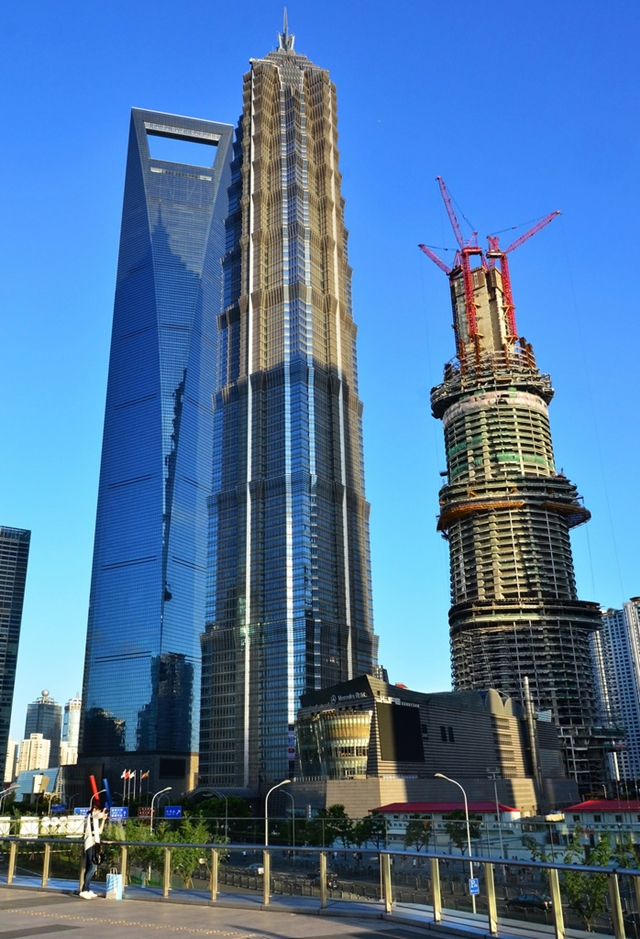 Shanghai Tower under construction with Jin Mao tower and World Financial Center