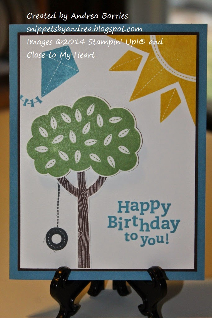A child's birthday card with bright colors and bold images: a tree and tire swing, a kite and the sun.