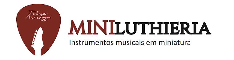 Miniatura de violões, guitarras e instrumentos musicais de corda