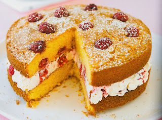 Raspberry and Lemon Polenta Cake: A rich layered sponge cake made with polenta and containing raspberries where the tow layers are sandwiched together with cream cheese
