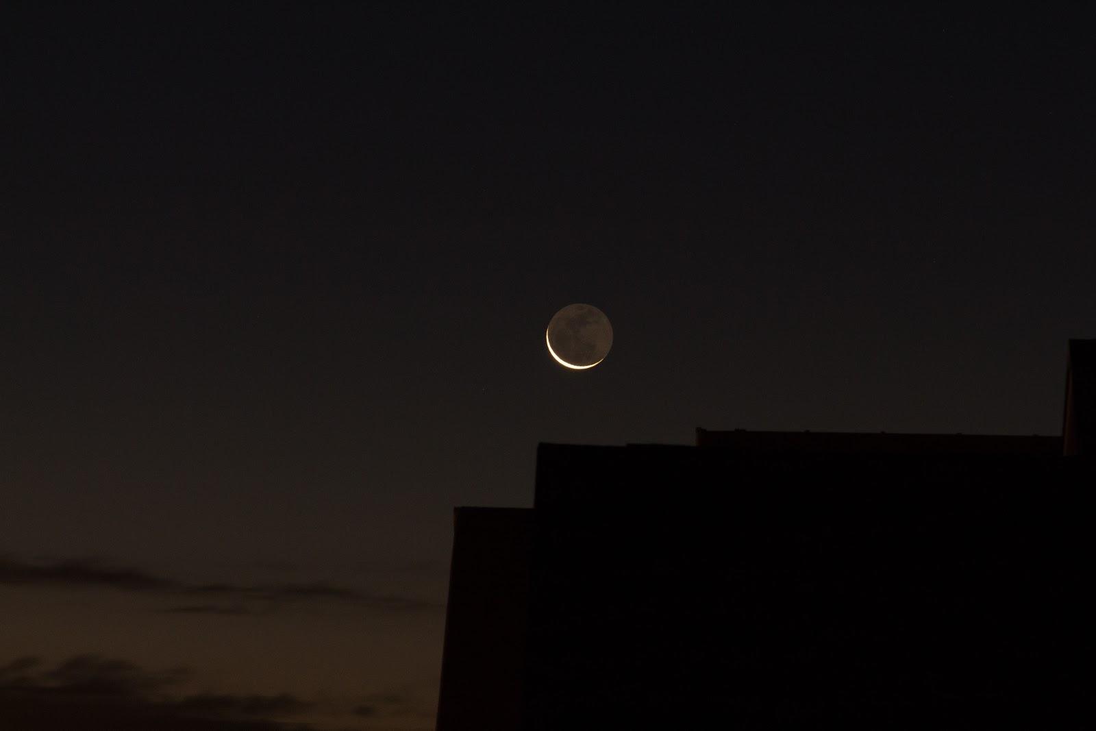 earthshine moon over roof