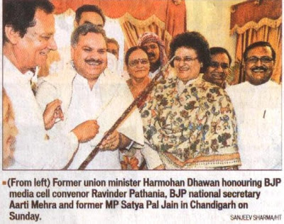 Former union minister Harmohan Dhawan honouring BJP media cell convenor Ravinder Pathania, BJP national secretary Aarti Mehra and former MP Satya Pal Jain in Chandigarh on Sunday.