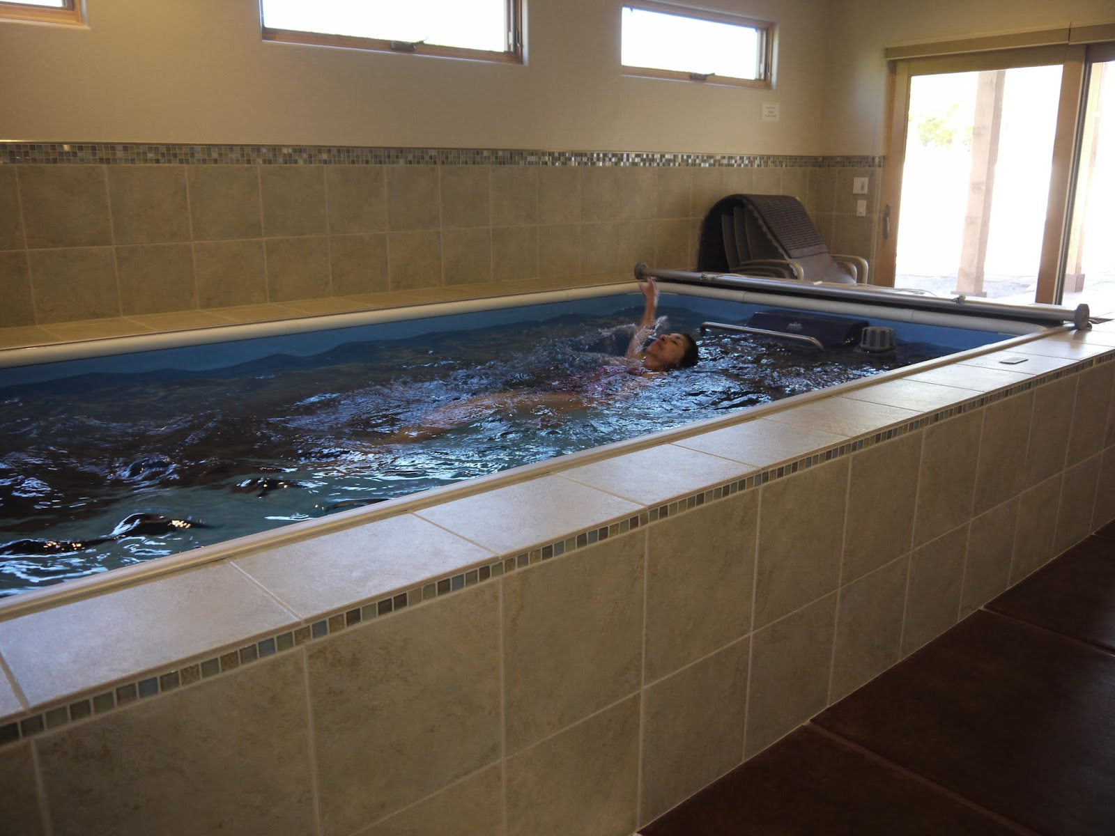 Couple chooses endless pool for energy efficient home - Inside swimming pool ...