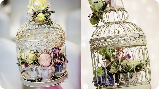 vintage themed wedding decorations birdcages filled with teacups & saucers with flowers