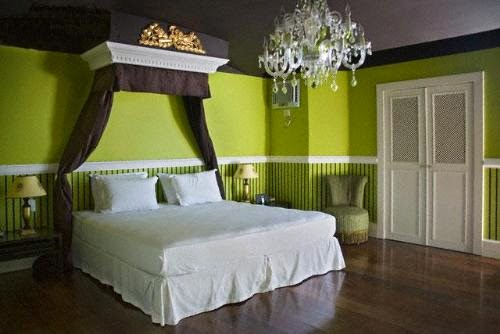 romantic green bedroom with antique lamp