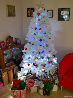 ma's little white tree, complete with presents