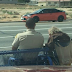 Cop's Touching Act Of Kindness Towards Old Man In Wheelchair Goes Viral