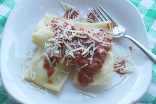 fresh ravioli, ragu pasta sauce, fresh shredded Parmesan