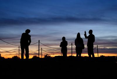 Tourists photographing the Washington Monument at dusk. Washington, DC.