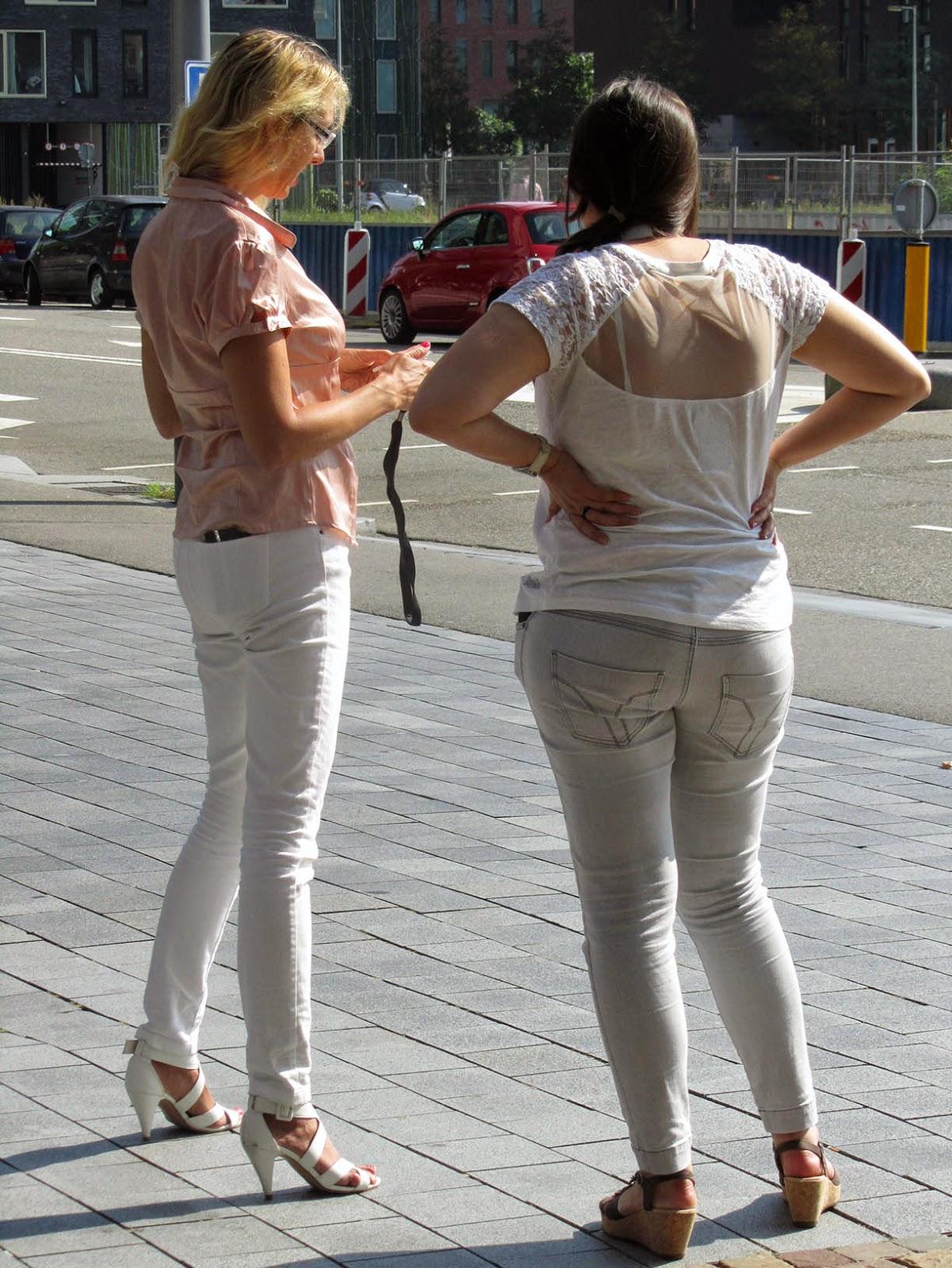 two women waiting around
