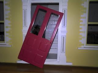 Broken door on the doll's house